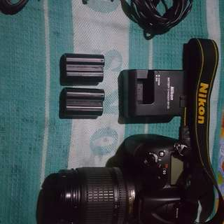 Nikon D7100 with 18-105 kit lens and spare battery