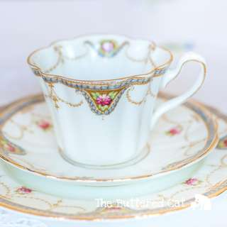 Exquisite antique English bone china tea trio, garlands and swags, ribbon bows and hand-coloured flowers