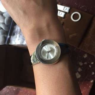 Gucci watch with inter-changeable metal and leather strap