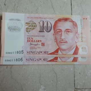 Singapore $10 note with number 211805 and 211806