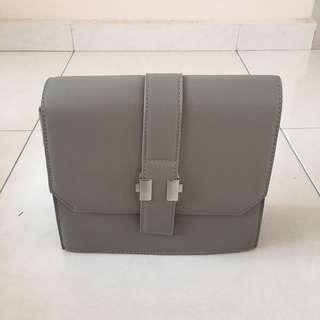 BN grey clutch bag