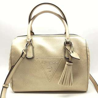 Authentic GUESS two-way bowling bag with long strap in Gold