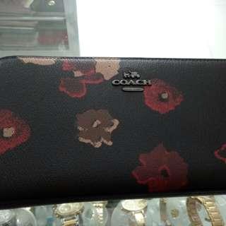 Coach floral handbags and wallet set
