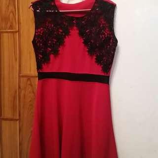 Red skater dress with mesh waistline details