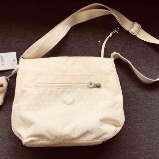ce9e857828bc Kipling Isla Bucket Bag Crossbody in beige