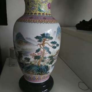 Porcelain Vase with delicate stroke of painting.
