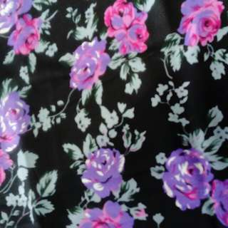 Dark purple flowers in black background fabric