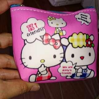 On hand hello kitty coin purse