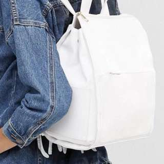 White leather gold zip backpack