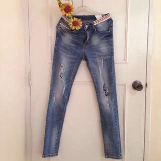 High-waisted Ripped Jeans