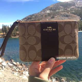 COACH Corner Zip Wristlet in Signature Coated Canvas with Leather Stripe - Light Gold/ Khaki