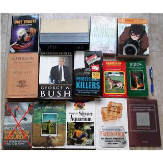 Many books: self-help finance management fiction reference fiction Dilbert military war