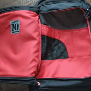 Crumpler The Dry Red No. 10 24L 55cm Carry On Cabin Spinner Luggage Black
