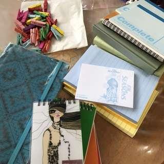 Notebooks, sticky note and mini clip