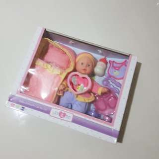 You & me baby doll toy