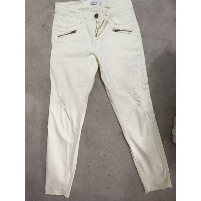 Cream distressed pants