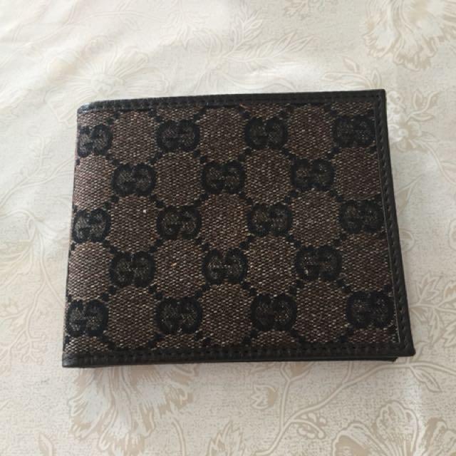 6cb44ce83e1 Gucci Men s classic bifold slim canvas and leather wallet (Dark ...