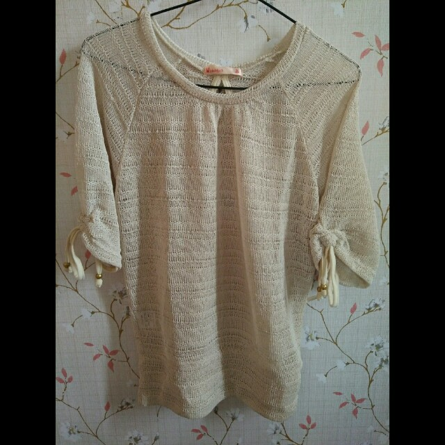 Nude top with ribbon at the back