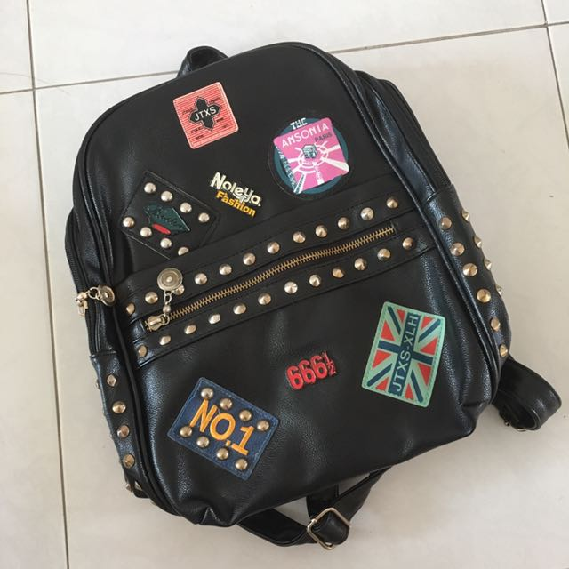 Studded badge leather bagpack