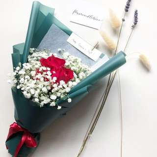 Three stalks I love you Red roses fresh flowers bouquet with white baby's breath in forest green wrapping paper