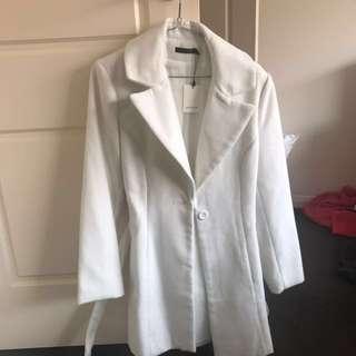 Portman's White Coat