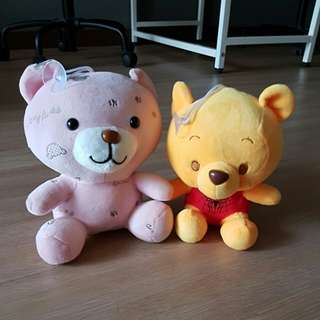 Winnie The Pooh Soft Toy with a Pink Bear