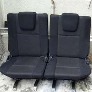 Seat belakang sekali Exora.