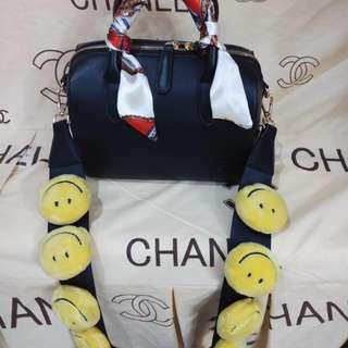 Black bag with smiley emoticon handle