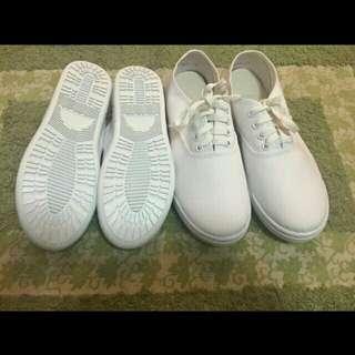 Plain white canvas shoes