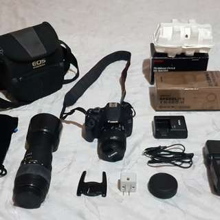 CANON EOS 1200D with 18-55 mm kit lens + SIGMA  Macro lens 70-300mm F4-5.6 + YONGNUO Speedlite Digital Auto Flash YN460-II + CANON Camera bag + tripod (not in the photo but it is in great condition)Complete with battery charger