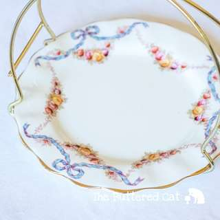 Collectible handled small plate basket for serving sweets and cookies at afternoon tea, blue ribbon bows, rose swags
