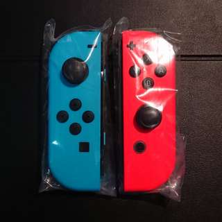 Pair of Original Nintendo Switch Joy-cons (Neon Blue and Neon Red)