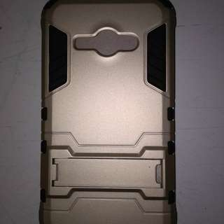 Case transfomers gold hp samsung J1 Ace