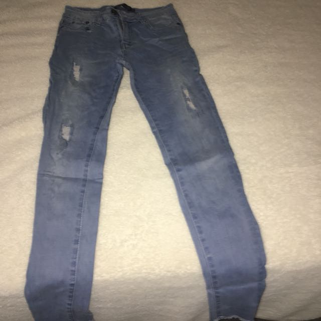 Light blue denim jeans with fake rips.