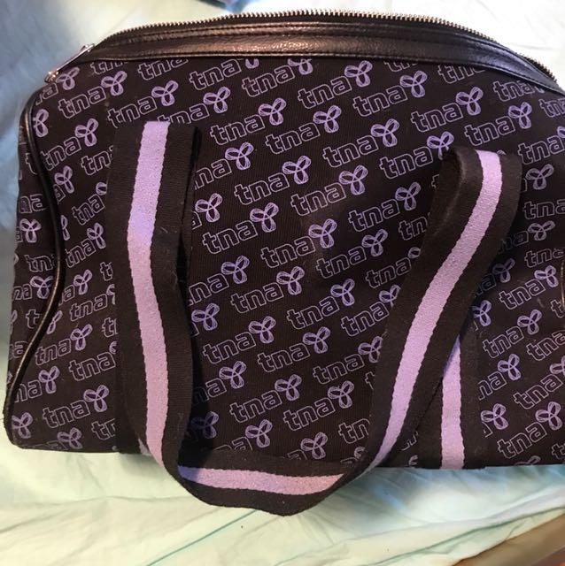 TNA purse