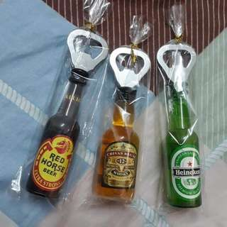 Miniature bottle opener with magnet