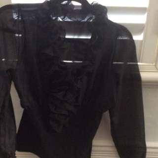 Ruffled black top