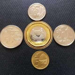 一套全新发光未流通过新加坡硬币