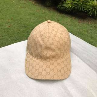 Gucci men's Gold Embossed Logo Cap