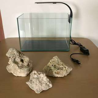 One week old small glass aquarium/fish tank with LED light and aquarium rocks