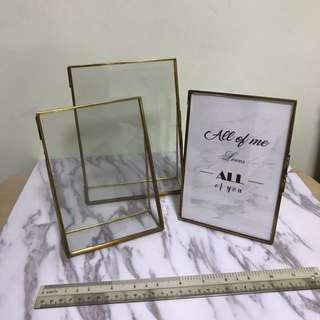 Gold rimmed rustic glass photo frames