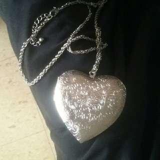 Pendant, locket , heart shape in gold n silver