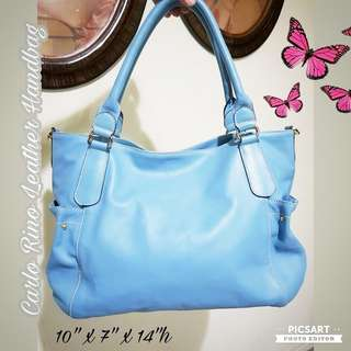 Lovely CARLO RINO Sky Blue Goat's Leather Women's Handbag. It has 3 large compartments inside (center one has zip) and Magnetic Button Closure at the top.  Good Condition, clean and no damage. $35 Offer, sms 96337309.