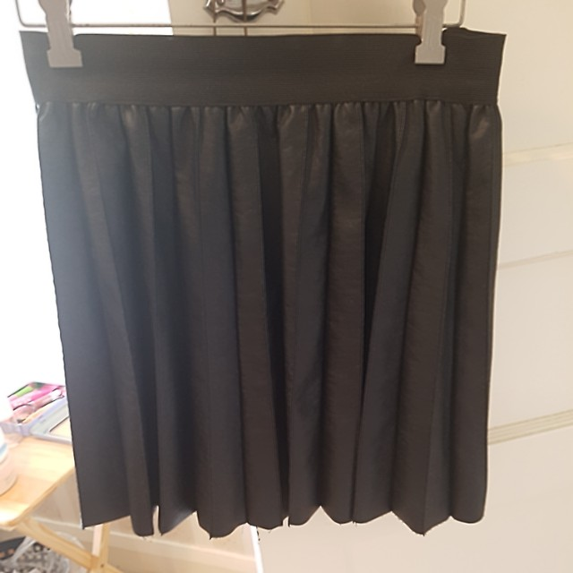 Pleated black skirt synthetic leather
