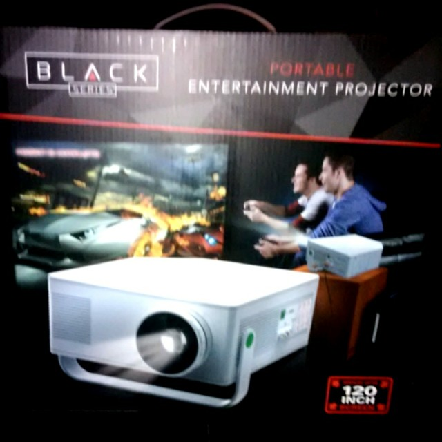 PORTABLE ENTERTAINMENT PROJECTOR 120 INCH SCREEN RCA JACK HEAD PHONE JACK AND CONTROLS FOR VOLUME ADJUST MENT FOR BUILT IN SPEAKER.  AND PICTURE CONTROL