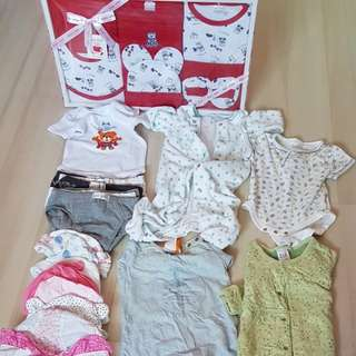 Mix of baby clothes, hats and bibs
