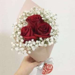 Red rose with white baby breath