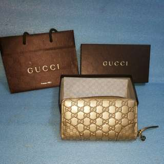 Brand new Gold Gucci long wallets
