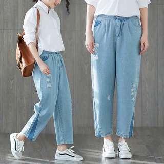 2018 spring jeans women's new loose trousers wild elastic waist light blue harem pants