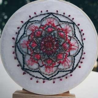 Mandala embroidery hoop art.
